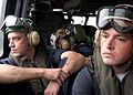 US Navy 050104-N-9403F-341 Sailors return to USS Abraham Lincoln (CVN 72) aboard an SH-60 Seahawk helicopter after spending the day assisting in humanitarian relief efforts at the Bande Aceh Airport, Sumatra Indonesia.jpg