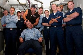 Bill Goldberg - Goldberg (wearing cap) during his tour of USS Ronald Reagan in 2005