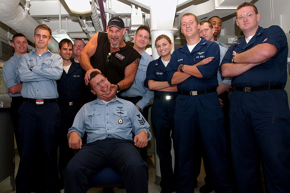 US Navy 050519-N-7130B-003 Professional wrestling champion and actor Bill Goldberg takes a moment to pose with the photographers of Operations Department%27s OP Division during his tour of USS Ronald Reagan (CVN 76)