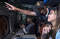 US Navy 050531-N-9851B-012 Fire Controlman 3rd Class James Martin explains weapon-targeting equipment to visitors aboard the guided missile destroyer USS John S. McCain (DDG 56).jpg