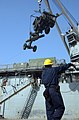 US Navy 051018-N-9288T-025 U.S. Navy Boatswain's Mate 2nd Class Galen Roberts directs a crane carrying a piece of heavy equipment while unloading supplies from the flight deck of the dock landing ship USS Pearl Harbor (LS.jpg
