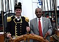 US Navy 060623-N-5367L-002 Commanding Officer, Cmdr. Thomas C. Graves, and Assistant Secretary of the Navy for Installations and Environment, the Honorable B.J. Penn, man the helm aboard USS Constitution.jpg