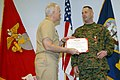 US Navy 070126-N-7918H-058 Operations officer Maj. Andrew Warren, 2nd Battalion, 6th Marine Regiment Combat Team Five, 1st Marine Expeditionary Force, receives the Bronze Star at Naval Amphibious Base Little Creek.jpg