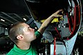 US Navy 070311-N-8590D-005 Aviation Electronics Technician Airman Kyle Purcell replaces grounding straps on the radar altimeter of an EA-6B Prowler.jpg
