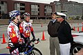 US Navy 070415-N-2903M-001 Commander, Carrier Strike Group Two Rear Adm. Mike C. Vitale and Louisville Navy League Senior Vice President, retired Capt. Greg Reinhardt chat with members of the Papa John's bicycle racing te.jpg