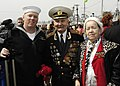 US Navy 070509-N-4649C-135 Mass Communication Specialist 2nd Class Robert Cole poses for a photograph with World War II veterans after filming a Victory Day celebration in Vladivostok.jpg