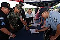 US Navy 070614-N-3390M-001 Religious Program Specialist 2nd Class Delmar Ramirez, right, visits Naval Station Everett's security department recruiting booth at a job fair held at the Smokey Point Naval Support Complex dur.jpg