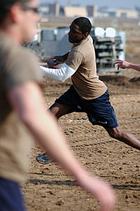 US Navy 080112-N-7367K-006 Builder 3rd Class Bryan Williams, assigned to Naval Mobile Construction Battalion (NMCB) 1, Task Force Sierra, scrambles out of a defender's reach in a two-hand-touch football game during the detachme.jpg