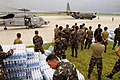 US Navy 080626-N-5961C-011 Servicemen of the Philippine Army stage themselves to transport bottled water to aircrafts assigned to the U.S. Navy and the Republic of the Philippines Air Force.jpg