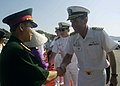 US Navy 080629-N-0209M-001 Capt. William Kearns, mission commander, Pacific Partnership 2008, greets a Vietnamese official at a closing ceremony that marked the Military Sealift Command hospital ship USNS Mercy's (T-AH 19) depa.jpg
