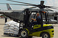 US Navy 080913-N-4515N-035 Service members embarked aboard the amphibious assault ship USS Kearsarge (LHD 3) load supplies onto helicopters for delivery to areas affected by recent hurricanes in Haiti.jpg