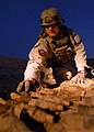US Navy 081205-N-6278K-272 Explosive Ordnance Technician First Class Ben Jones, assigned to Explosive Ordnance Disposal Mobile Unit One (EODMU) 1, gathers unexploded ordnance for disposal.jpg