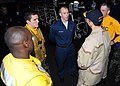 US Navy 090119-N-7571S-004 Adm. Jonathan W. Greenert, speaks with Seaman Christopher McGuire and Aviation Boatswain's Mate (Handling) Victor Seeley and in the hangar bay during his brief visit aboard the aircraft carrier USS Th.jpg