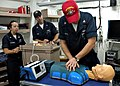 US Navy 090124-N-2604W-572 Hospital Corpsman 3rd Class Sarah Pilipovich and Hospital Corpsman 2nd Class Robert Sides look on as Machinery Repairman 2nd Class Joseph Trotta practices cardiopulmonary resuscitation.jpg