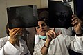 US Navy 090318-N-7948C-032 Lt. Cmdr. Shay Razmi, a nurse corps officer deployed with Africa Partnership Station embarked aboard the amphibious transport dock ship USS Nashville (LPD 13), reviews an X-ray with a Nigerian Navy de.jpg