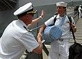 US Navy 090612-N-2456S-111 Cmdr. Brian Peterson, executive officer of the amphibious transport dock ship USS Nashville (LPD 13), congratulates Aviation Boatswain's Mate (Fuel) 3rd Class Daniel Zubiria after a five-month deploym.jpg