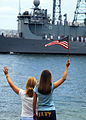 US Navy 090615-N-8539M-098 Family members of Sailors aboard the Oliver Hazard Perry class guided-missile frigate USS Crommelin (FFG 37) wave good-bye as the ship departs Naval Station Pearl Harbor for a scheduled six-month depl.jpg