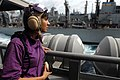 US Navy 090630-N-9132C-026 Aviation Boatswain's Mate (Fuel) Alanna Velasquez stands watch aboard the aircraft carrier USS Ronald Reagan (CVN 76) during a replenishment at sea.jpg