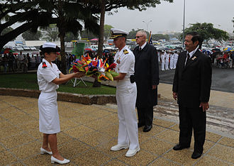 Jean Leques during a ceremony honoring U.S. service members who helped ensure the freedom of New Caledonia during World War II US Navy 090925-N-8721D-037 Capt. Thom Burke, commanding officer of the amphibious command ship USS Blue Ridge (LCC 19) receives a wreath to lay at the U.S. war memorial during a ceremony.jpg