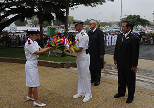 US Navy 090925-N-8721D-037 Capt. Thom Burke, commanding officer of the amphibious command ship USS Blue Ridge (LCC 19) receives a wreath to lay at the U.S. war memorial during a ceremony