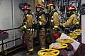 US Navy 091112-N-7014G-002 Machinist's Mate 3rd Class Kelly Christie leads the firefighting assessment team during a main space fire drill aboard the amphibious assault ship USS Wasp (LHD 1).jpg