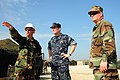 US Navy 100223-N-9643W-003 Rear Adm. Robert Wray, deputy commander of Military Sealift command, center, tours the White Beach logistical compound at Varreoux Beach in Port-au-Prince, Haiti.jpg