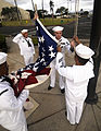 US Navy 100415-N-7586L-089 Sailors assigned to Joint Base Pearl Harbor-Hickam prepare to raise the flag during morning colors.jpg
