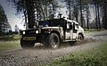 US Navy 100428-N-6538W-036 Sailors drive a high mobility multipurpose vehicle during an HMMV training course at Fort Lewis, Wash.jpg