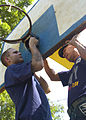US Navy 110629-N-VY256-066 A U.S. Navy and an Armed Forces of the Philippines Navy sailor replace a basketball goal during a community service proj.jpg