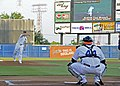 US Navy 110709-N-GC639-092 Rear Adm. Ted Branch throws the first pitch of the Norfolk Tides baseball game.jpg