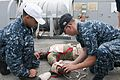 US Navy 110909-N-PB383-136 Hospital Corpsman 3rd Class Benoit Cisneros observes Seaman Juan Villagarcia provide medical assistance to Hospital Corp.jpg