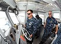 US Navy 110919-N-JB593-032 Capt. Nelson P. Hildreth observes Chief Boatswain's Mate Richard Kinney as he drives the new dive vessel.jpg