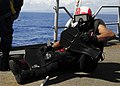 US Navy 110927-N-WJ771-049 Electronics Technician 3rd Class Jonathan A. Simmons prepares to enter the water during a man overboard drill aboard USS.jpg