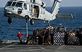 US Navy 111221-N-OY799-341 An MH-60S Sea Hawk helicopter from the Eightballers of Helicopter Sea Combat Squadron (HSC) 8 picks up stores.jpg