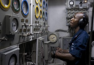 US Navy 120110-N-TZ605-186 Machinist's Mate 2nd Class Demale Crews charts gauge readings in an emergency diesel generator space.jpg