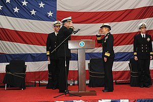 US Navy 120112-N-VA840-031 Rear Adm. Gregory M. Nosal, incoming commander of Carrier Strike Group (CSG) 2, left, salutes outgoing commander Rear Ad.jpg