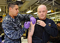 US Navy 120208-N-ZZ999-025 Hospital Corpsman 2nd Class Christian J. Huerta administers an anthrax shot to Chief Navy Counselor James Coogan in the.jpg