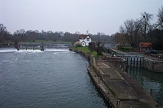 Locks and weirs on the River Thames - Goring Lock demonstrates the common juxtaposition of weir, lock island, lock keeper's house and lock