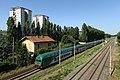 Un convoglio Trenord transita sulla linea ferroviaria Milano-Mortara nei pressi del ponte di via Brunelleschi a Milano.jpg
