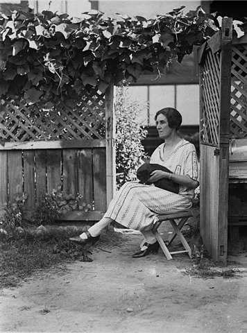 File Unidentified Women Sitting On Stool In Garden With