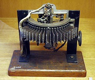 Strowger switch - Western Electric 7A Rotary, friction drive (Bird-cage), No. 7001 Line Finder. Note the driven bevel gear on the right-hand side; this type has a steady rotary motion and does not employ an electromagnet for stepping.