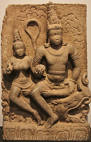 Varuna - Varuna with Varunani. Statue carved out of basalt, dates back to 8th century CE, discovered in Karnataka. On display at the Prince of Wales museum, Mumbai.