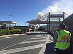 Vehicle on fire outside the Brisbane Airport Domestic Terminal.jpg