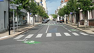 Shared lane marking - Advisory lane (on the right) and shared lane (on the left) in Vichy, France