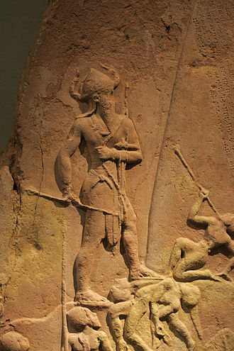 Victory Stele of Naram-Sin - King Naram-Sin standing over Lullubian corpses (detail).