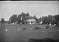 View of the bowling green and club house at Cambridge, circa 1920. ATLIB 293519.png