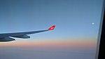 Virgin Atlantic over the Ocean as the Sun rises.jpg