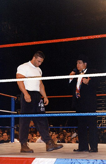 Shamrock (left) being interviewed by World Wrestling Federation commentator Jim Ross in 1997 WWE- Birmingham 200997 (16).jpg