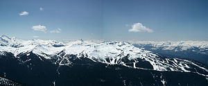 Whistler Blackcomb - Whistler Mountain, as seen looking south from Blackcomb Mountain. The original Whistler area starts mid-frame and extends down and to the right. Whistler Peak is just to the right of the fold. To the left of the peak is the Harmony Bowl area, Little Whistler Peak, and then the recently opened Symphony Bowl. The Black Tusk can be seen in the distance between Whistler Peak and Little Whistler.