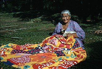Culture of the Cook Islands - Woman sewing a tivaevae patchwork quilt.